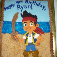 "Jake And The Neverland Pirates Cake  This was a chocolate cake with chocolate buttercream icing. I used fondant for Jake, the sky, and underneath the ""water."" Sand is..."