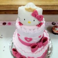 Hello Kitty Bridal Shower Cake  Yes, a Hello Kitty Bridal Shower Cake. Kitty is RKT covered in fondant. Cake is covered in buttercream. Hearts, bows, veil and tiara are...