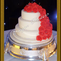 "Cara Chocolate 10"" and 6"", vanilla 8"". With 45 handmade roses. Also a diamante 'ribbon' around each tier. TFL"