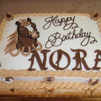 Horse Theme Marble cake iced with buttercream. All decorations are chocolate.