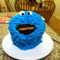 Cookie Monster  just used a giant cupcake pan and cut the top to make it more round and then used the grass tip all over...my daughter loved it and so did...
