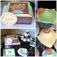 Monkey Theme Baby Shower 8' chocolate cake with chocolate whipped topping decorated with ivy and lambs papagayo monkey to match nursery, with sleeping baby...