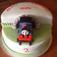 Thomas The Tank Engine Chocolate cake covered in fondant for my little one I take care off. he loves Thomas Thomas is a toy so he could play with it after