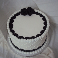 "Black And White This was a rushed cake. Under the icing and decorations is a 8"" round Styrofoam dummy. I was to lazy to color icing, I kept the dots..."