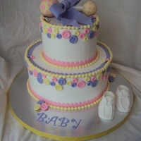 It's A Girl! BC icing. Fondant decorations including rattle and booties