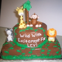 Safari Baby Cake all animals are made with rkt and covered in mmf.