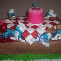 What Happens When The Smurfs Throw Disney's Ariel A Birthday Party?   Vanilla cake with vanilla buttercream, gumpaste smurfs, modeling chocolate ariel, fondant picnic decorations, and tablecloth,
