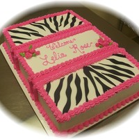 Zebra Hot Pink Baby Shower Butter cream with fondant zebra and ribbon roses.