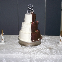 Bride/groom Combo Half And Half Half vanilla fondant, Brides side. Grooms side Chocolate fondant.I dont know who first made this cake, so I can't give them credit....