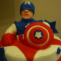 Captain America 4Th Birthday Allergen Free cake with Captain America Theme. Dairy free buttercream and all fondant decorations. Some inedible supports in sculpted...
