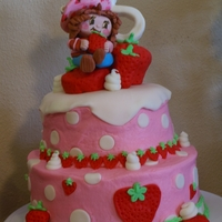 A Berry Sweet Cake  5th Birthday Cake. Strawberry Shortcake and the number 5 are gumpaste. The large strawberries are made from cupcakes. Gluten free, dairy...