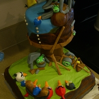Angry Birds In Action 30th Cake for my hubby. White cake with cottoncandy buttercream. Buttercream and fondant accents. All pieces were hand sculpted. There are...