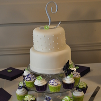 A Simply Elegant Cream Fondant Covered Two Tiered Cake The Top Layer Had Dots The Bottom Just A Plain Band Around The Bottom The Simple C A simply elegant cream fondant covered two tiered cake. The top layer had dots, the bottom just a plain band around the bottom. The simple...