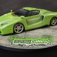 Ferrari Enzo   35 servings of one hard car to sculpt. It was a sweet 16 cake for a very wealthy girl. She picked the color.