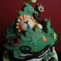Jungle   This was a real fun cake to make. All the characters are Modeling past an the vines are fondant and piped chcolate butter cream.