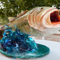 Big Mouth Bass  85 servings of a Large Mouth bass Cake on top of 20 servings of cake in the base covered with pulled sugar for the water effect. This guy...