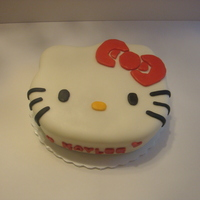 Hello Kitty I hand Carved this cake. A friend wanted hello kitty but I didnt have the pan. I baked a 10X3 round. Once it was frozen I carved, torted...