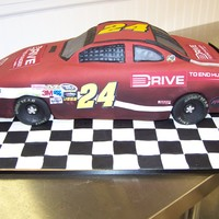 Jeff Gordon #24 I made this for a huge Jeff Gordon fan, so I wanted everything correct. Cake is hand carved, raised off the base, covered in fondant and...