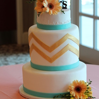 Spring Time Chevron Cake This cake was delivered at 8:30 am for a morning wedding where they have a full waffle bar and Omelet station! Happy Spring!Fresh Flowers