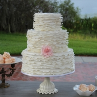White Ruffled Wedding Cake I made this for an amazing vintage wedding in Orlando, FL. The rose is gumpaste and each tier was a different flavor.