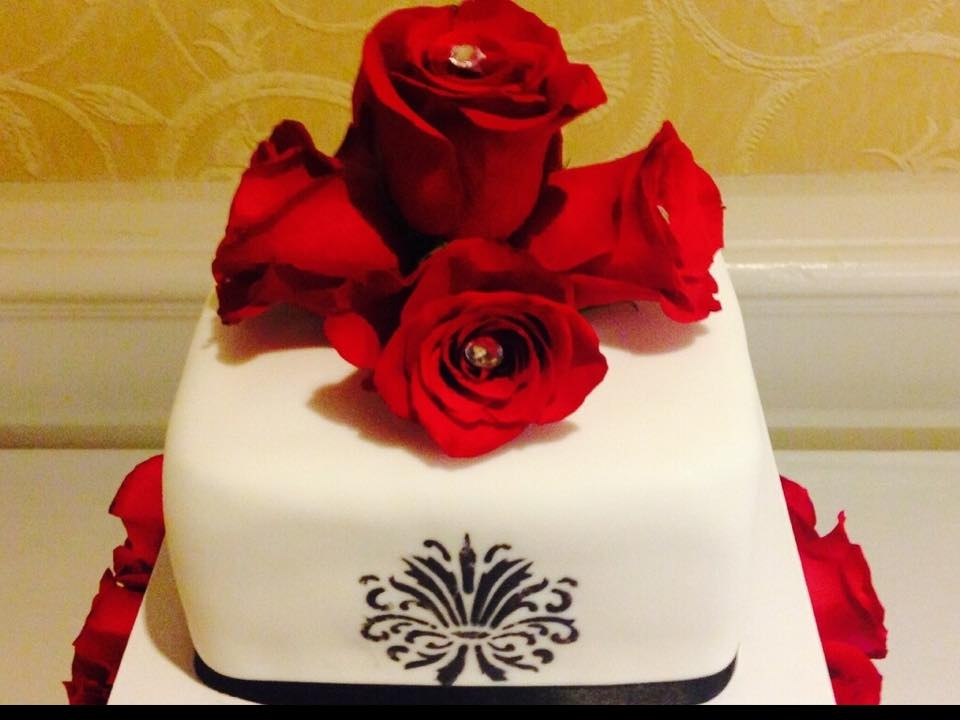 Rose Wedding Cake With Hand Stenciling I used real roses with diamonds I attached and hand stenciled the 1st and 3rd tiers.
