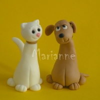 Cat And Dog Made of gumpaste - as a part of a cake topper.