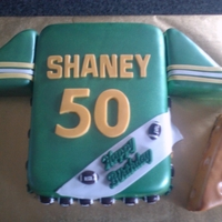 Football Jersey B-Day Cake Marble cake covered in fondant and decorated to look like a greenbay jersey.