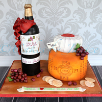 Wine And Cheese Wheel Cake wine and cheese wheel cake. Wine is carved chocolate cake, and cheese wheels too. labels were hand painted Icing sheets. Crackers, grapes...