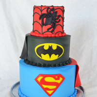 Super Hero Cake Super hero cake. BC w/ fondant logos and capes.