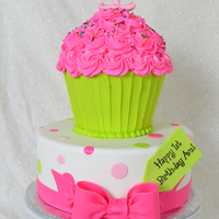 "Cupcake Cake Top Tier - BC ""wrapper"" and BC icing w/ fondant #1Bottom tier - fondant w/ fondant bow and tag"
