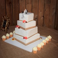 Jennifer's Wedding Cake Reception was in an amazing barn in the area. Flavors were orange cake/white chocolate ganache, champange cake/strawberry filling, almond...