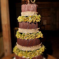 4 Tier Cake Covered With Chocolate Cigarellos   4 tier cake covered with chocolate cigarellos.