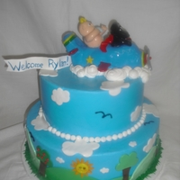 Baby And Dog Flying Mommy to be loved the cake. Daddy is a pilot. Buttercream and fondant.