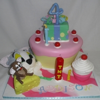 Tom And Jerry Loved this cake. Fondant covered and all accents are fondant, rice krispies. Little girl was so happy.