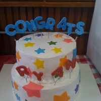 Congrats Ryan Bottom Tier-yellow, top tier-chocolate with buttercream frosting and satin ice star accents. The letters are gumpaste with cake sparkles...
