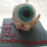 "Is This Your Eye ? This cake was for my sons' 15th birthday - 6"" fondant covered choc cake, on fondant hand."