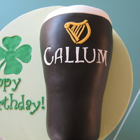 "A Glass Of Guiness This cake was for my sons' 22nd birthday - he was born on St.Patricks' Day :)11"" long, 4.5"" high. Jaffa mud cake with..."