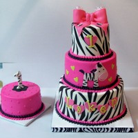 "Wild About One Small 3 tier (4/6/8) cake with 5"" rd smash cake. Made to match the party theme. BC finish with fondant zebra and zebra stripes, bow..."