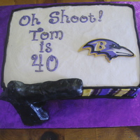 Tom's 40Th Birthday  Made for a friend's 40th. Very hard to tie in his love of the Ravens and shooting guns but that is what I came up with. Rice Krispie...