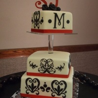 Justine This beautiful damask cake features elements that matched perfectly with Justine and Scott's reception. The bottom tier was almond...
