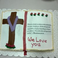 Pastor Appreciation Book pan. Buttercream icing, shell border. Fondant cross with purple fondant to look like material. A Scripture printed on computer paper...