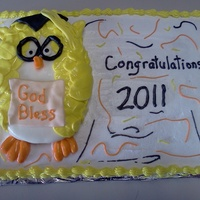 Owl Graduation Cake The cake is a 12x18 iced with buttercream icing. Shell border. The owl is an oval cake covered in fondant. The feathers were made with an...