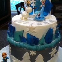 Disney Frozen Theme Cake Olaf Elsa Disney ~ Frozen Theme. Bottom (4 layers) chocolate fudge cake w/chocolate mousse filling. Iced with chocolate ganache, painted silver.Top...