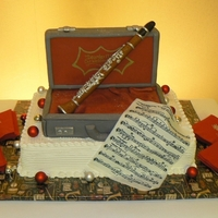 Clarinet Cake This was a sugar replica of the Groom's tiny clarinet. The case and all are edible