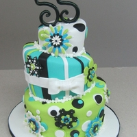 Funky Flowers This cake was made for a 55th birthday! Topsy turvy funky flower style!