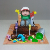 Handy Manny Well we sure had fun making this cake ! I think the main character has cake in his cheeks! haha