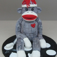 Sock Monkey This cake was made for a girl that loves sock monkeys so what better to give her for her birthday than a sock monkey cake.He sits on her...
