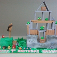 Angry Birds Angry Birds Cake ,Rice crispy wooden pieces ,fondant birds & pigs