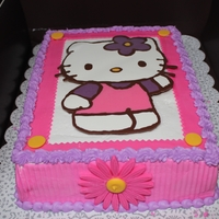 Hello Kitty Cake Yellow cake with vanilla filling, sugarshacks buttercream, chocolate transfer hello kitty, and fondant flowers.