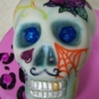 Sugar Skull Birthday Cake Hand carved skull cake for my daughter's friend. Vanilla cake with mmf.